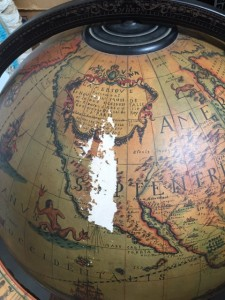 Photo of a damaged globe bar