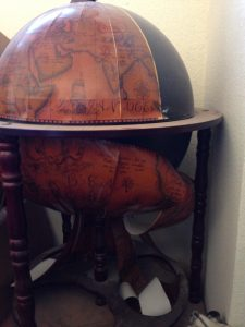 Image of nautical bar globe with stickers coming off
